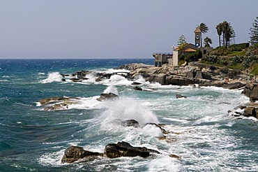 Surf and Rotonda Sant Ampelio Chapel at the cape, Bordighera, Riviera, Liguria, Italy