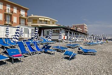 Deck chairs on the pebble beach, Bordighera, Riviera, Liguria, Italy, Europe