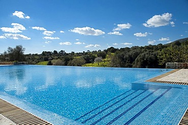 Swimming pool in a green landscape, Finca Son Mas, near Porto Cristo, Majorca, Balearic Islands, Spain, Europe