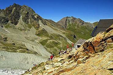 Hikers at the Moiry Hut, Pennine Alps, Valais, Switzerland, Europe