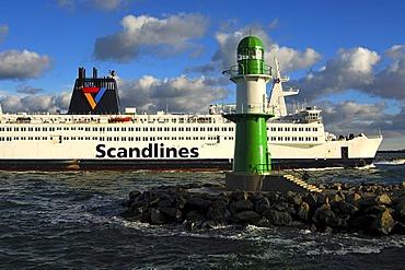 "Scandlines ferry ""Kronprins Frederike"" passing the lighthouse at the Warnemuende harbor entrance, Rostock-Warnemuende, Mecklenburg-Western Pomerania, Germany, Europe"