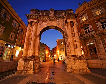 Triumphal Arch of the Sergii at night in Pula, Croatia, Europe