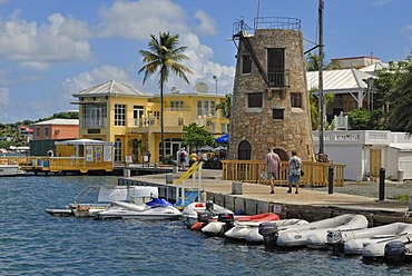 Boardwalk with Wedding Tower at the harbor of Christiansted, St. Croix island, U.S. Virgin Islands, United States
