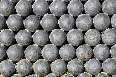 Historic cannon balls, welded together, Fort Christiansvaert, Christiansted, St. Croix island, U.S. Virgin Islands, United States