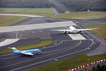 Duesseldorf International Airport, Emirates Airbus A330 on the taxiway to the runway, followed by KLM Cityhopper Fokker 70, Duesseldorf, North Rhine-Westphalia, Germany, Europe