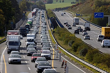 Traffic jam in the reduction of 3 to 2 lanes at a highway construction site on the A2 motorway, near Bielefeld, North Rhine-Westphalia, Germany, Europe