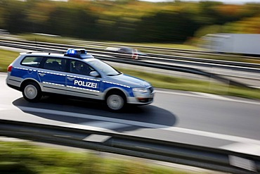 Police patrol car with flashing lights, Germany, Europe