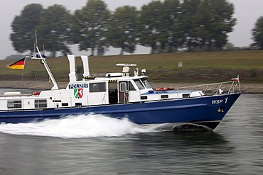 Boat of the water police patrolling on the Rhine river at Duisburg, North Rhine-Westphalia, Germany, Europe