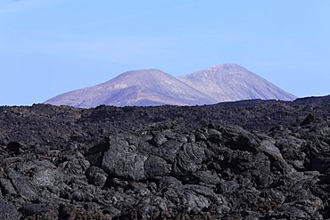 Sea of lava in Timanfaya National Park, Lanzarote, Caldera Blanca at back, Canary Islands, Spain, Europe