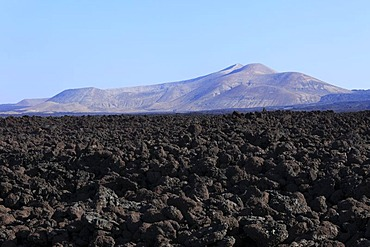 Sea of lava in Timanfaya National Park, Caldera Blanca at back, Lanzarote, Canary Islands, Canary Islands, Spain, Europe