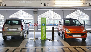 Charging station for the electrical cars of a rental car company in a public garage in Dusseldorf, North Rhine-Westphalia, Germany, Europe