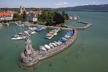 Overlooking the harbour of Lindau with the monument of a lion looking over the lake designed by the sculptor Johann von Halbig, Lindau on Lake Constance, Bavaria, Germany, Europe