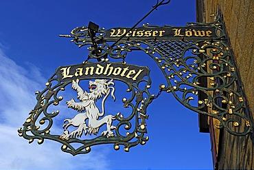 """Inn sign """"Weisser Loewe"""" against blue sky, Herrengasse 5, Eckental, Middle Franconia, Bavaria, Germany, Europe"""