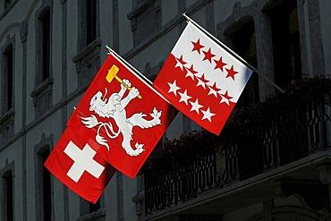 Swiss flag, flag of Valais, in Martigny, Valais, Switzerland, Europe