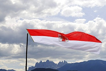 State flag fluttering over the Odle group, Dolomites, South Tyrolean eagle, South Tyrol, Italy, Europe