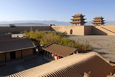 Jiayuguan fortress with two gatehouses at the western end of the Great Wall with trees in autumn colours, Silk Road, Gansu, China, Asia