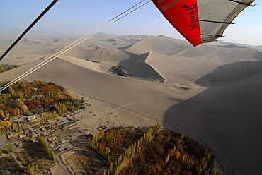 Microlight flight over the Gobi Desert, aerial view of Crescent Lake and the sand dunes in the Gobi Desert, Silk Road, Dunhuang, Gansu, China, Asia