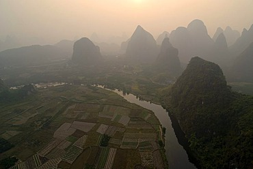 Rocky karst landscape with Yulong River and paddies near Yangshuo, aerial, Guilin, Guangxi, China, Asia