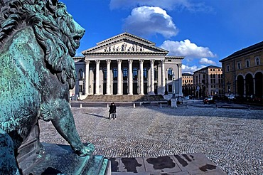 Lion statue and the Bavarian State Opera House, Munich, Upper Bavaria, Germany, Europe