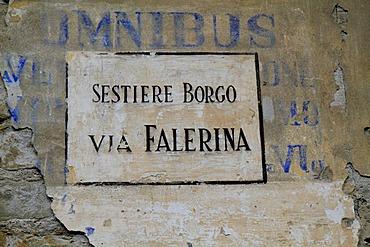 Street sign, Sestiere Borgo Via Falerina, painted on a wall over faded blue painted lettering, Omnibus, in the historic town centre of Ventimiglia, province of Imperia, Liguria region, Riviera dei Fiori, Mediterranean Sea, Italy, Europe