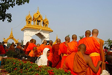 Theravada Buddhism, That Luang Festival, Tak Bat, monks standing together, orange robes, Vientiane, Laos, Southeast Asia, Asia
