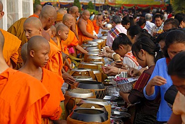 Theravada Buddhism, That Luang Festival, Tak Bat, monks standing behind begging bowls, believers, pilgrims giving alms, orange robes, Vientiane, Laos, Southeast Asia, Asia