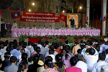Event of the Communist Party in the Pathet Lao cave, Tham Sang Lot Elephant Cave, a long table with many delegates in front of a portrait of the former Prime Minister Kaysone Phomvihane, Vieng Xai, Houaphan province, Laos, Southeast Asia, Asia
