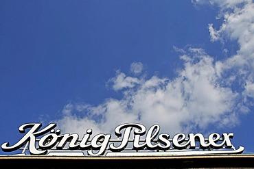 Koeng Pilsener advertising sign at the main station of Duisburg, North Rhine-Westphalia, Germany, Europe