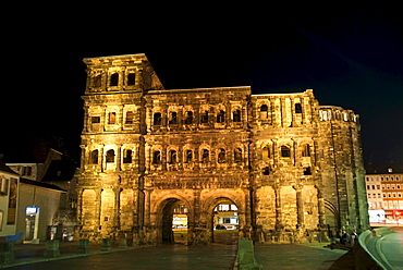 The back side of the Porta Nigra by night, the right part is the rest of a church, Trier, Rhineland-Palatinate, Germany, Europe