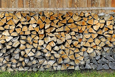 Firewood stacked outside a hut