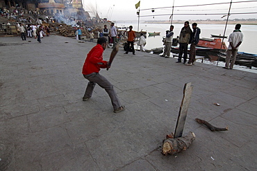 Cricket game in front of Burning Ghat cremation ground, Varanasi, India, South Asia