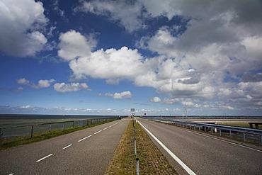 Highway road on the dyke between North Holland and Friesland, Afsluitdijk, Ijsselmeer, Netherlands, Europe
