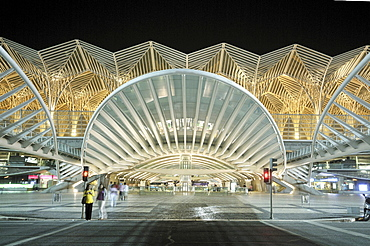 Gare do Oriente train station at night, architect Santiago Calatrava, on the grounds of the Parque das Nacoes park, site of the Expo 98, Lisbon, Portugal, Europe