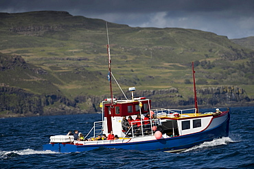 Fishing boat in front of the Inner Hebrides, Isle of Mull, Scotland, UK, Europe