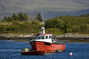 Fishing boat in the bay between the Isle of Mull and Ulva, Scotland, UK, Europe
