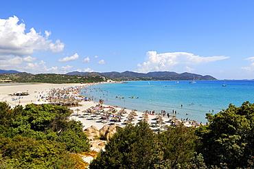 Bathing tourists and colorful parasols on the beach, crystal clear turquoise water, Cala Giunco, Porto Giunco, Capo Carbonara, Villasimius, Sardinia, Italy, Europe