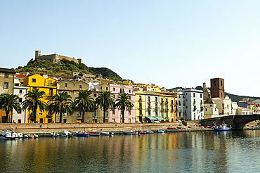 Overlooking the river Temo and the historic town centre with Malaspina Fortress, Bosa, Oristano, Sardinia, Italy, Europe
