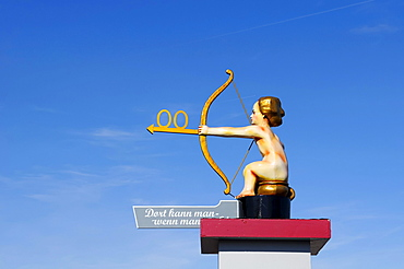 Guidepost to the toilet, angel with a bow and arrow, Oktoberfest, Munich, Upper Bavaria, Bavaria, Germany, Europe