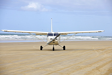 Aircraft on Seventy-Five Mile Beach, an official highway, the world's only official beach airport on a sand runway, UNESCO World Natural Heritage Site, Fraser Island, Great Sandy National Park, Queensland, Australia