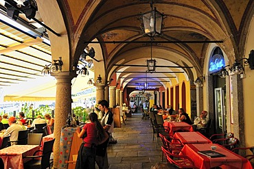 Arcades along the promenade with street restaurants, Lago Maggiore, Cannobio, Piedmont, Italy, Europe