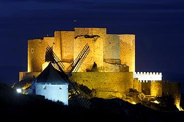 Windmill and Caballeros de San Juan de Jerusalen Castle at dusk, 12th century, Consuegra, Toledo, Route of Don Quixote, Castilla-La Mancha, Spain, Europe