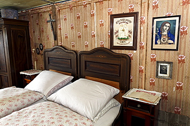 Farmer's bed-room with double bed, pictures of saints on the wall, Haus Haeusing house, farm from 1734, Wolfegg farmhouse museum, Allgaeu region, Upper Swabia, Baden-Wuerttemberg, Germany, Europe