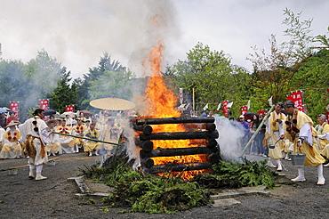 Yamabushi followers, mountain ascetics, Buddhist sect, pushing cedar branches off the fire with bamboo poles, Iwakura, Japan, East Asia, Asia