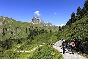 Hikers on Hochtannbergpass, Lechtal Alps, Vorarlberg, Austria, Europe