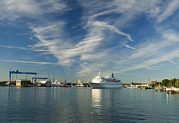 Inner fjord of Kiel with a cruise ship and the HDW shipyard, state capital of Kiel, Schleswig-Holstein, Germany, Europe