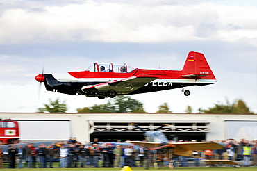 Czech sports and aerobatic aircraft Zlin Z-526 immediately after take-off, Europe's largest meeting of vintage planes at Hahnweide, Kirchheim-Teck, Baden-Wuerttemberg, Germany, Europe