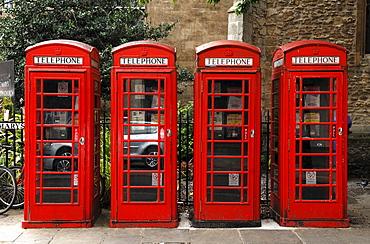 Four English red telephone booths, St. Mary's Street, Cambridge, Cambridgeshire, England, United Kingdom, Europe