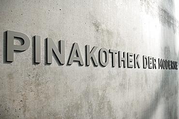 Signage, Pinakothek der Moderne on the concrete facade of the museum, Barer Strasse 40, Munich, Bavaria, Germany, Europe
