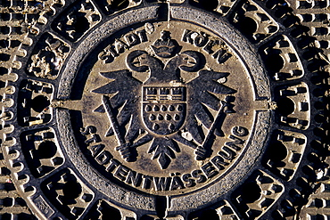 Cologne coats of arms on manhole cover, road, urban drainage of Cologne, North Rhine-Westphalia, Germany, Europe