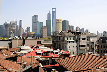 Old and new, view over the historic city centre of Shanghai and The Bund towards the skyline of the Pudong financial district with Jin Mao Tower and the World Finance Building across the Huangpu River, Shanghai, China, Asia